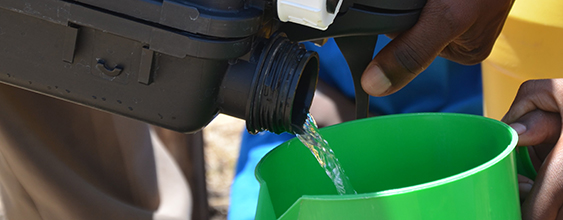 Image of a jar being filled with potable water