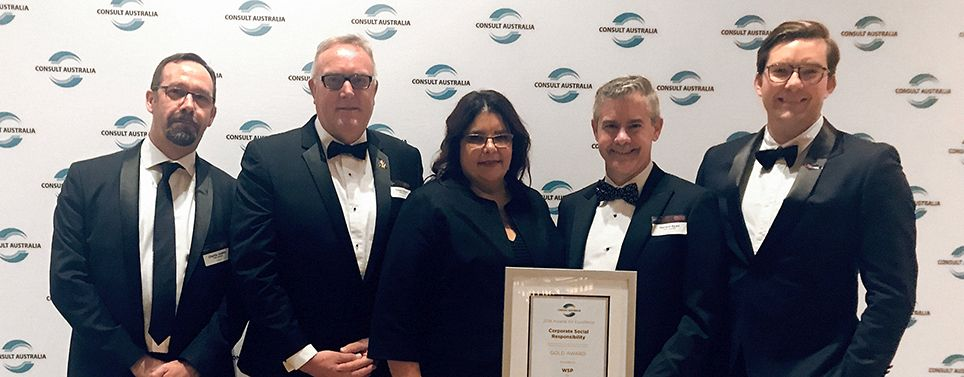 Charlie Jewkes, Casey Dwyer, Anita Lee Hong, Gerard Ryan and Josh Loyd celebrating their Consult Australia award win