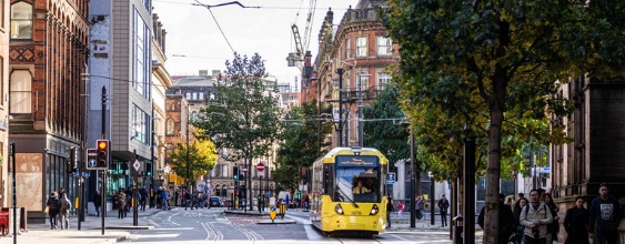 Busy central Manchester road with running tram