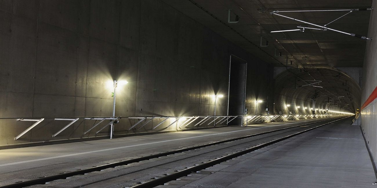 View into the Katzenberg Tunnel with fixed track, overhead contact line and safety lighting | WSP