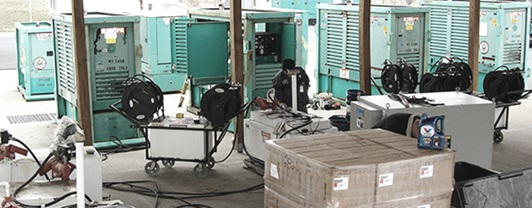 multiple green generators in various states of repair