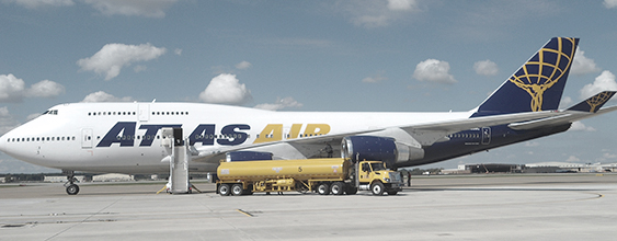 Atlas Air jet being refueled by fuel truck as it sits on the tarmac