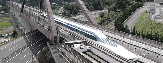 aerodynamic maglev train travelling across a bridge over an interstate