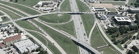 Aerial view of multiple Texas highways and Interstates merging into a complex intersection