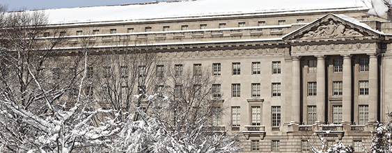 Exterior view of snow-covered US Department of Justice Building in Washington DC
