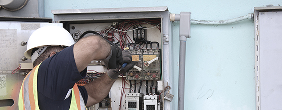 WSP emergency technician performing a repair on an electrical box
