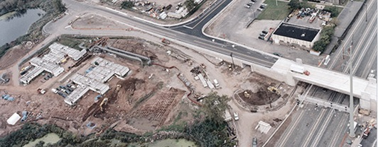 Aerial view of Potter's field excavation site next to highway