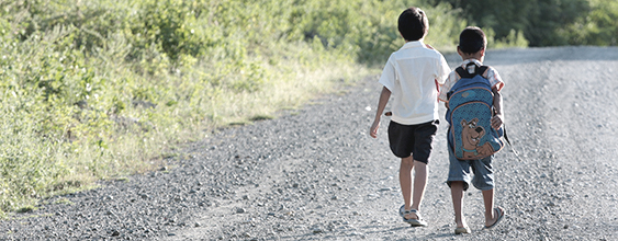 Two children walk along a Philippine road where WSP was selected to develop a road management program