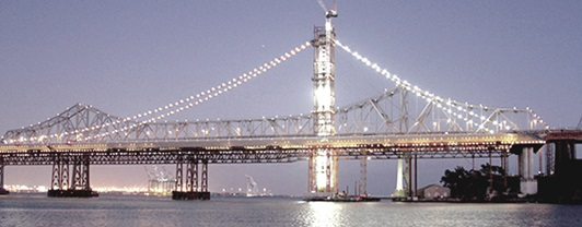 Night time view of the San Francisco Oakland Bay Bridge after earthquake repairs were completed by WSP