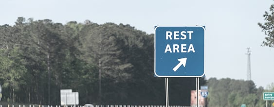 Blue roadside rest area sign