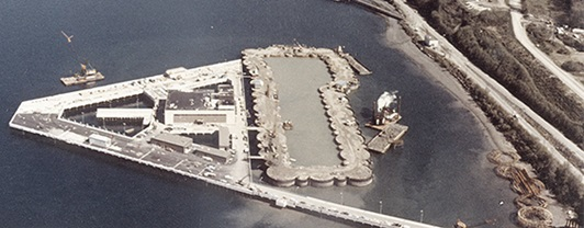 Aerial view of the triangular-shaped submarine berthing facilities in Bangor, WA