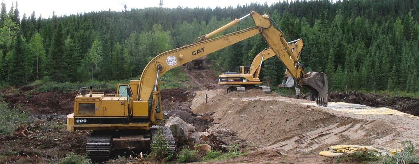 Tractor moving soil - Ground Risk and Remediation services - WSP